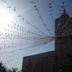 Volksfest Wimpel Sonne Uhr Turm Sardinien